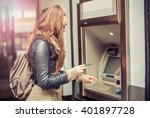 Young Woman Withdrawing Money...