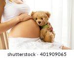 Pregnant Woman Holding Teddy...