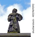 Small photo of A small sandstone statue of John Knox on a granite arch in Charlotte Street. Although the building was constructed as a college in 1887, the statue is much older.