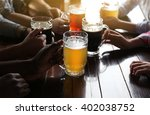 friends drinking beer in pub | Shutterstock . vector #402038752