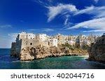 polignano a mare in a summer... | Shutterstock . vector #402044716