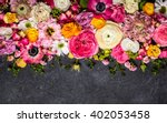 Stock photo various flowers on black background overhead view with copy space 402053458