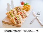 Stock photo four sandwiches on the board 402053875