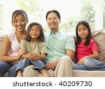 young family relaxing on sofa... | Shutterstock . vector #40209730