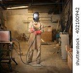 sculptor holding welder in a... | Shutterstock . vector #402100942