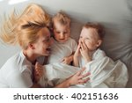 beautiful mother having fun... | Shutterstock . vector #402151636