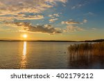 Yellow Sunset Over Lake With...