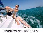 smiling girl in glasses sitting ...   Shutterstock . vector #402218122