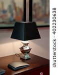 lamp with a black shade on a... | Shutterstock . vector #402230638