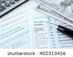 1040 income tax form and dollar ... | Shutterstock . vector #402313426