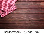 checkered napkin on wooden... | Shutterstock . vector #402352702