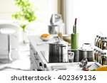 modern table and electric stove ... | Shutterstock . vector #402369136