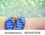 flip flops by the swimming pool | Shutterstock . vector #402442456