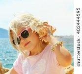 little girl listening to the...   Shutterstock . vector #402444595