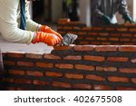 workers masonry clay brick to... | Shutterstock . vector #402675508