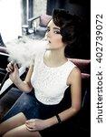 young  beautiful woman smokes a ... | Shutterstock . vector #402739072