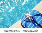 flip flops by the swimming pool | Shutterstock . vector #402786982