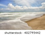 Waves Breaking Gently On A...