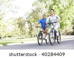 senior couple cycling in park | Shutterstock . vector #40284409