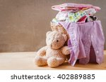 clothes in a laundry basket on... | Shutterstock . vector #402889885