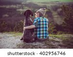 woman and her dog posing... | Shutterstock . vector #402956746