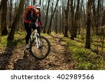 mountain biker riding on bike... | Shutterstock . vector #402989566