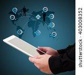 businessman holding a tablet ... | Shutterstock . vector #403008352