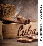 Постер, плакат: Cigar and tobacco leaf