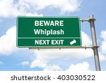 Small photo of Green overhead road sign with a Beware of Whiplash Next Exit concept against a partly cloudy sky background.