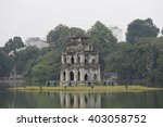 Small photo of View of Turtle Tower on a small island on Hoan Kiem lake (known as Jade lake). This area is the center of Hanoi capital, Vietnam.