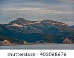 mountain top row of wind... | Shutterstock . vector #403068676