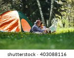 couple camping. young couple... | Shutterstock . vector #403088116