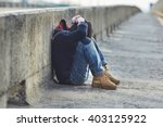 Stock photo young homeless boy sleeping on the bridge poverty city street 403125922