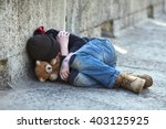 Stock photo young homeless boy sleeping on the bridge poverty city street 403125925
