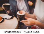 bride and groom holding coffee... | Shutterstock . vector #403157656