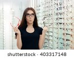 woman choosing eyeglasses...   Shutterstock . vector #403317148