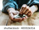 hand the old man and pile coin... | Shutterstock . vector #403326316