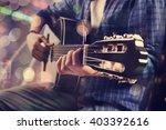 young man playing guitar | Shutterstock . vector #403392616