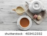 milk tea with tea pot on white... | Shutterstock . vector #403412332