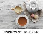 milk tea with tea pot on white... | Shutterstock . vector #403412332