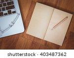 empty notebook on laptop... | Shutterstock . vector #403487362