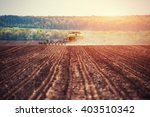 tractor plowing farm field in... | Shutterstock . vector #403510342