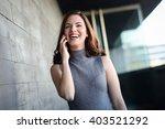 beautiful young woman talking...   Shutterstock . vector #403521292