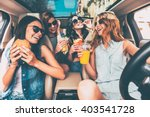 enjoying their lunch in the car.... | Shutterstock . vector #403541728