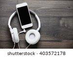 white headphones and smart...   Shutterstock . vector #403572178