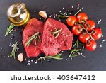 Raw Steak With Spices And...