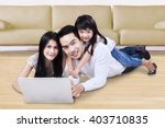happy asian family using a... | Shutterstock . vector #403710835