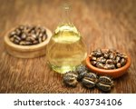 Castor Beans And Oil In A Glas...