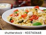 farfalle pasta   caprese salad... | Shutterstock . vector #403760668