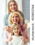 portrait of three generations...   Shutterstock . vector #403802566